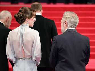Britain&#39s Catherine, Duchess of Cambridge talks with British director Sam Mendes (R) on arrival for the world premiere of the new James Bond film &#39Spectre&#39 at the Royal Albert Hall in London on October 26, 2015. The film is directed by Sam Mendes and sees Daniel Craig play suave MI6 spy 007 for a fourth time. AFP PHOTO / LEON NEAL