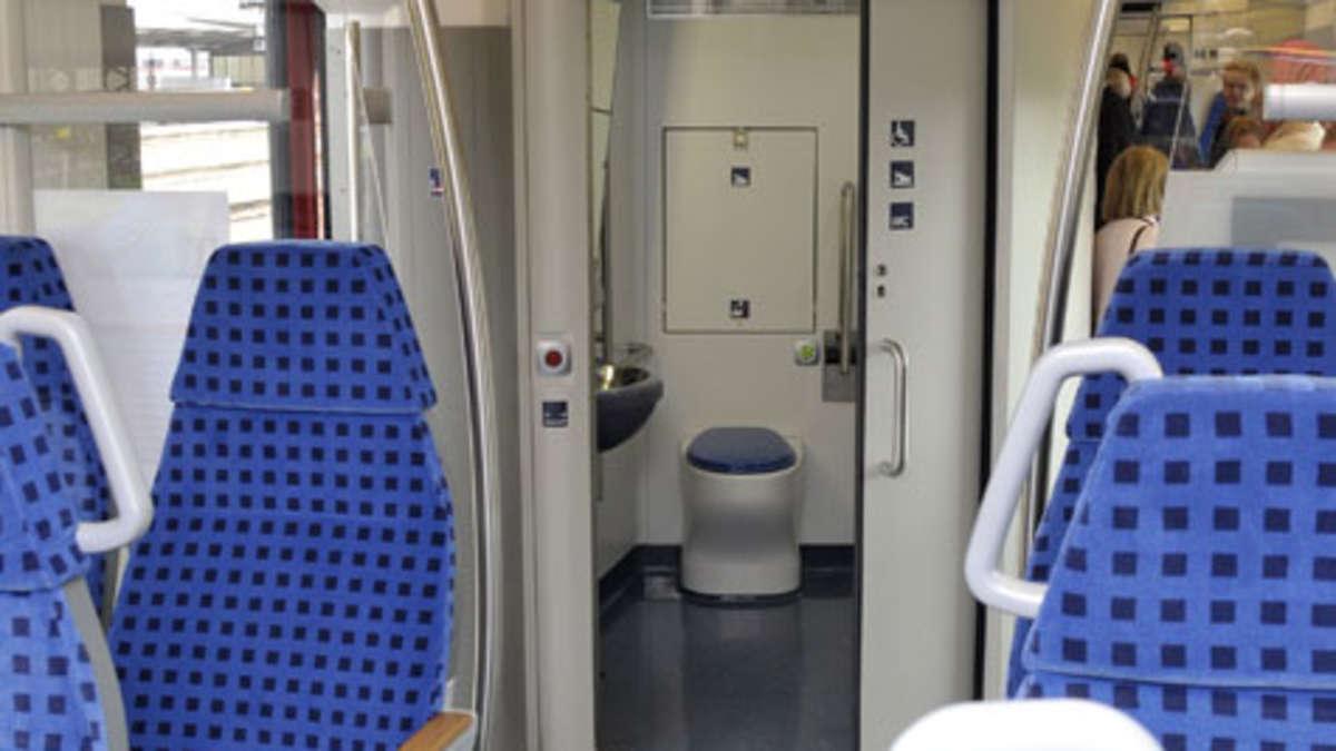 frau findet euro auf zug toilette und gibt sie ab. Black Bedroom Furniture Sets. Home Design Ideas
