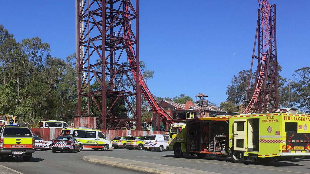 Emergency services vehicles are seen outside the Dreamworld theme park at Coomera on the Gold Coast.