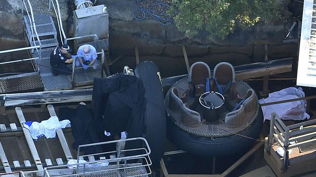 A file picture dated 25 October 2016 shows Queensland Emergency service personnel inspecting the scene of an accident at the Dreamworld theme park, in Coomera.
