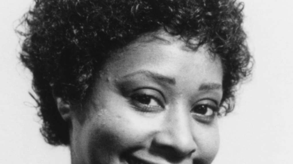 "Marion Ramsey im Film ""Police Academy""."